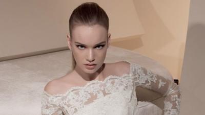 Bolerko do sukni ślubnej zapinane z tyłu na perełki