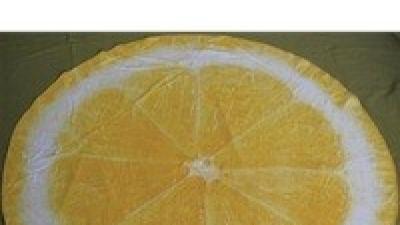 Okrągły ręcznik jak plaster kiwi lub orange