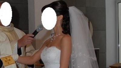 Piękna suknia ślubna z długim welonem 34/36