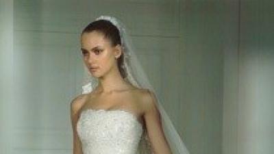 Śliczna suknia ślubna Madonny, model HOMENAJE