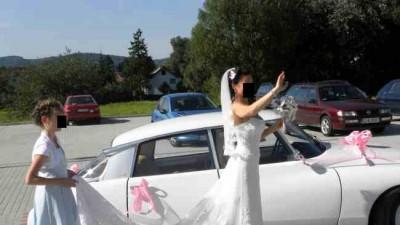 Sprzedam elegancką,koronkową suknię z pięknym długim trenem -roz.36-38
