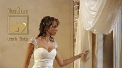 Sprzedam przepiękną, ponadczasową suknię ślubną z koronki 36/38