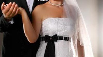 sprzedam suknie ślubną wyjątkową z czarną kokardką!