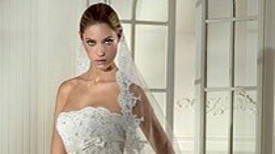 Sprzedam suknię z długim trenem model Nalon