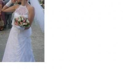 Sprzedam wdzięczną białą suknię ślubną rozmiar 36 wiązaną na szyi