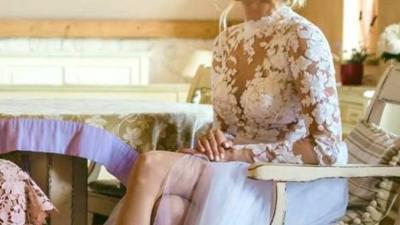Suknia ślubna koronka długi rękaw odkryte plecy