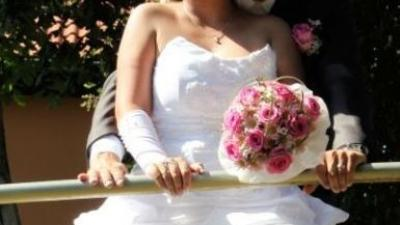 Wyjątkowa suknia ślubna krótka z przodu
