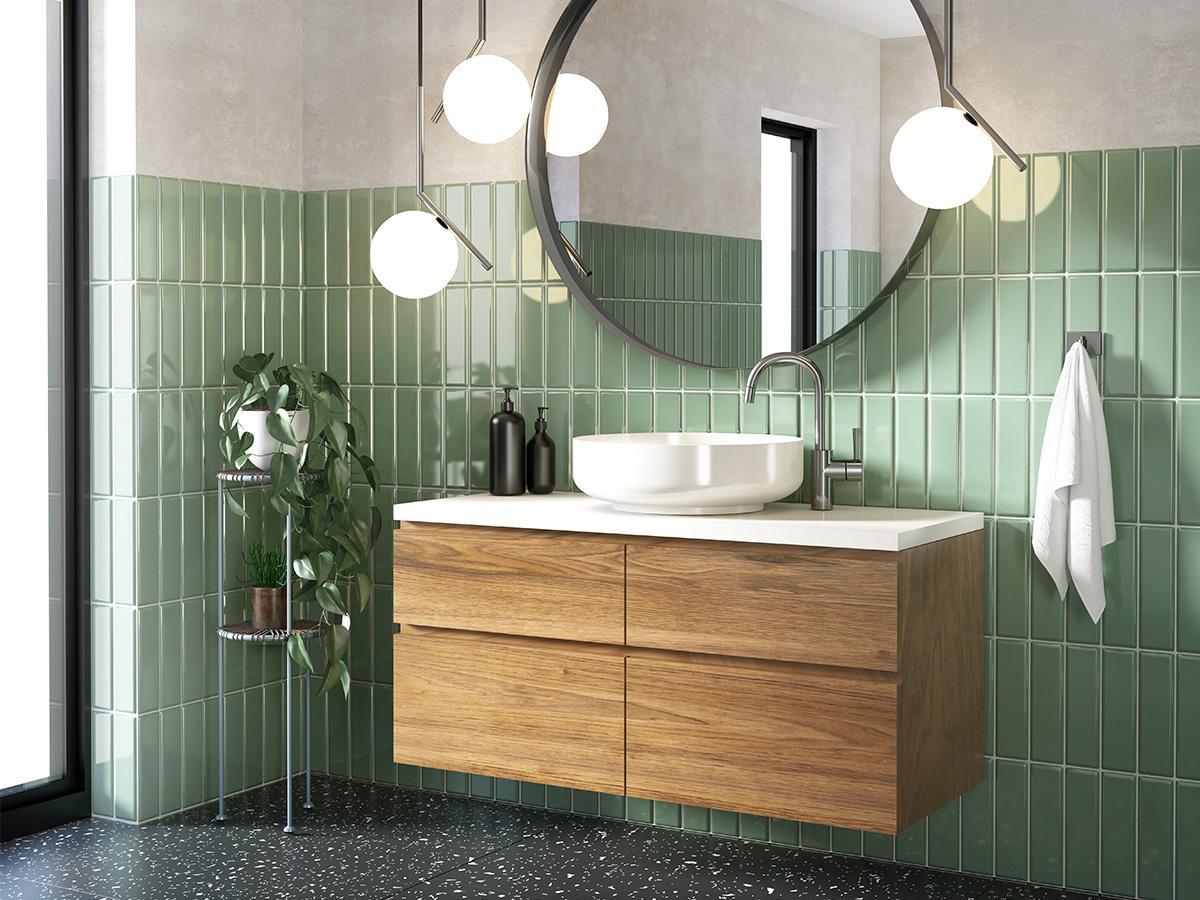 Zielone płytki cegiełki w nad umywalką w łazience