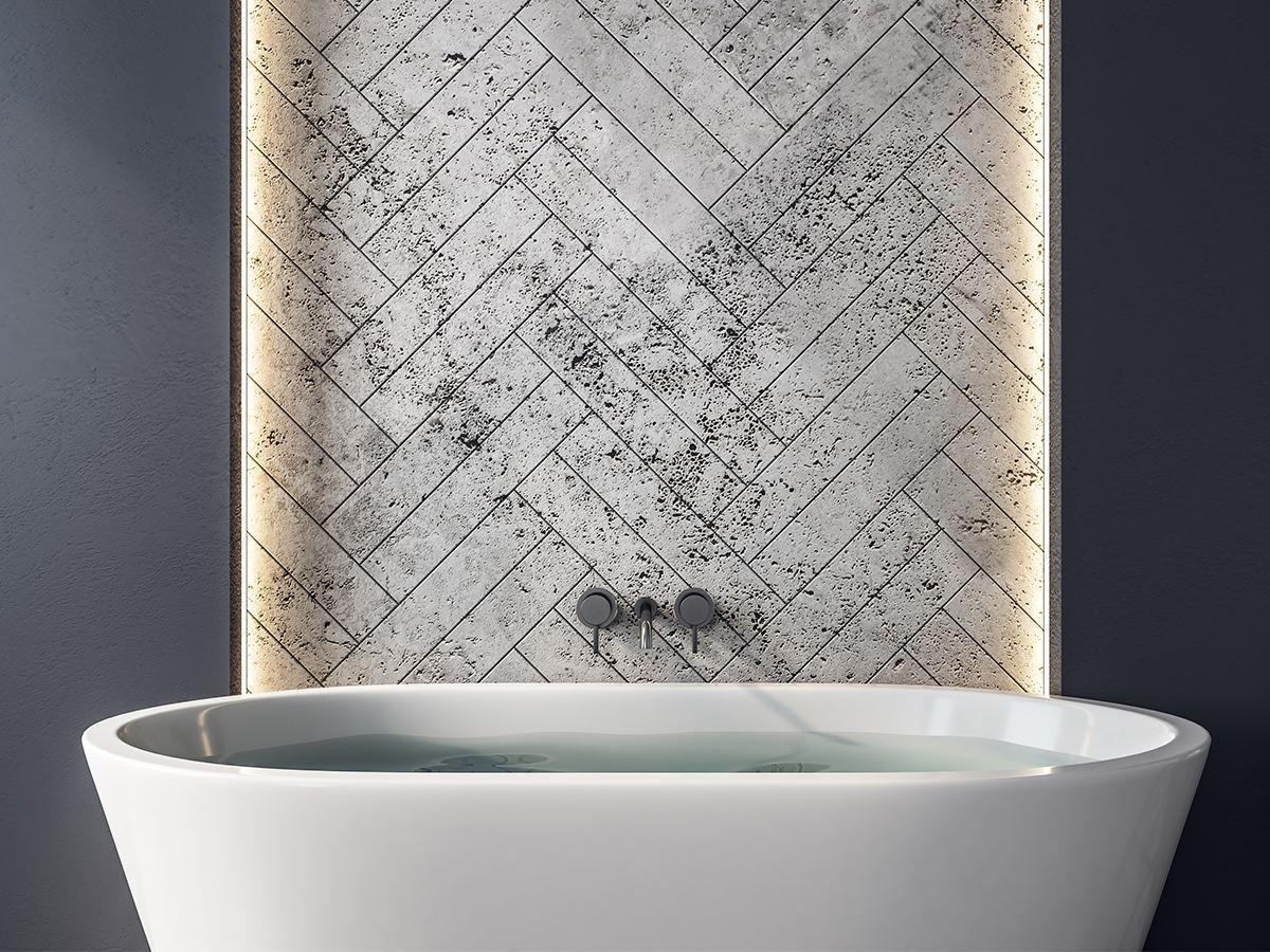 Płytki cegiełki nad wanną ułożone w jodełkę