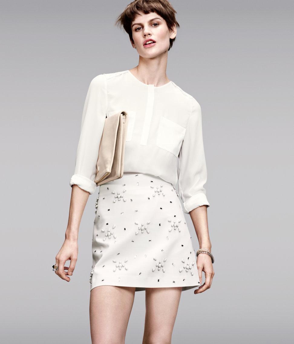 spódniczka H&M z koralikami w kolorze białym - moda na wiosnę 2013