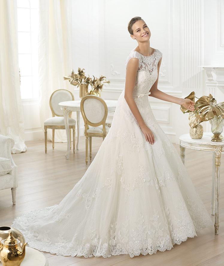 suknia ślubna Pronovias z kokardą zabudowana