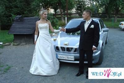 Delikatna,efektowna suknia ślubna
