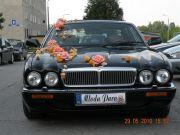 Jaguar XJ czarna limuzyna do ślubu ślub wesele randka