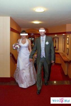 Biała jednoczęściowa suknia ślubna z salonu Gracja