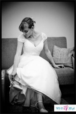 Elegancka, a zarazem dziewczeca suknia tiulowo-taftowa