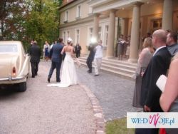 Niezwykle elegancka suknia ślubna Mariees de Paris