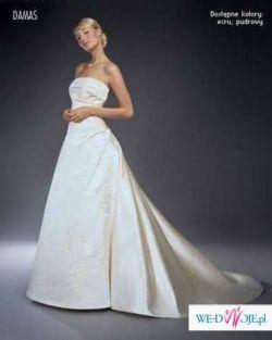 Piękna i suknia dla subtelnej Panny Młodej