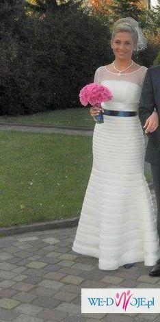przepiękna elegancka suknia ślubna