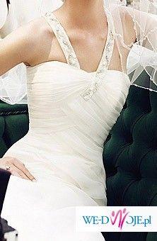 Śnieżnobiała hiszpańska suknia, model z 2009 r.