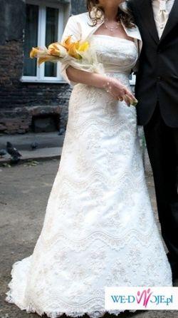 Sprzedam elegancką suknię ślubną ecru z koronką