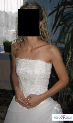 Sprzedam piękną suknię ślubną z trenem