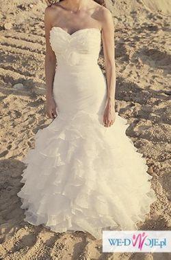 Sprzedam piękną suknię z trenem