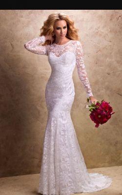 Sprzedam przepiękną suknię ślubną z Salonu Evita 38 40