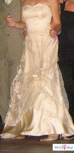 Sprzedam suknię wieczorową, która może być również ślubną.