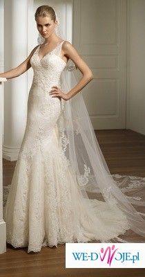 Suknia Pronovias Ronda z kolekcji 2009!Piekna, koronkowa, kolor waniliowy.