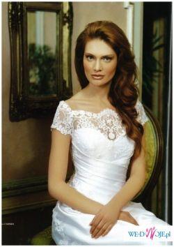 Tanio sprzedam delikatną suknię z salonu Carmen