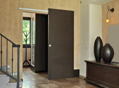 Drzwi przesuwne - praktyczne rozwiązanie czy nowoczesny kaprys? Czytaj więcej!