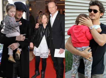 Przystojni ojcowie ze swoimi dziećmi