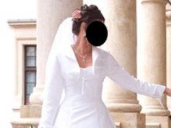 Biała, jednoczęściowa elegancka suknia ślubna