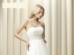 Biała suknia z muślinu wraz z koronkowym bolerkiem