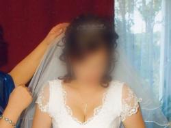 Delikatna suknia ślubna, biała, jednoczęściowa