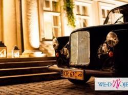 elegancka Londynska Taksowka biala skora i barek