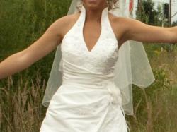Elegancka subtelna i bardzo kobieca suknia ślubna ze stójką