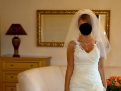 Oryginalna i piękna suknia ślubna firmy Cosmobella, model 7309, 2009r.