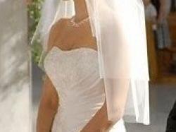 piękna suknia ślubna Cosmobella w kolorze ivory rozm. 36, za 1300 zł.