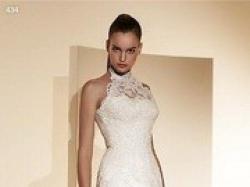 Piękna suknia ślubna Madonna, model White One 434, kolor ivory.
