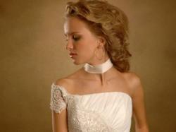 Piękna suknia ślubna projektu Oksany Muchy