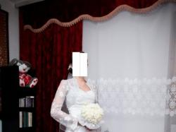 Skromna i elegandzka suknia ślubna