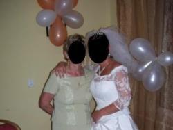 Śliczną,białą suknie ślubną