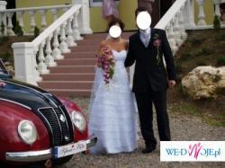 Śliczna mieniąca się w słońcu suknia ślubna rozm 36/38 Gustowan i niebanalna