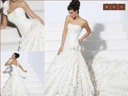 Sprzedam oryginalną suknię ślubną rozm 36-38, z trenem, biała