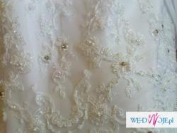 Sprzedam piękną, białą suknię ślubną z tafty, zdobioną kamieniami Svarowskiego