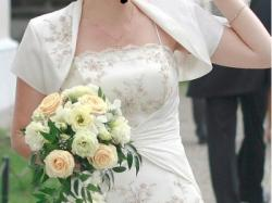 sprzedam piekną suknie ślubną z regulacją-wiązana z tyłu