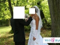 sprzedam sliczna białą jednoczęściową suknie w rozmiarze 36