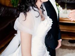 Sprzedam śnieżnobiałą suknię ślubną dla wysokiej panny młodej (40/42)