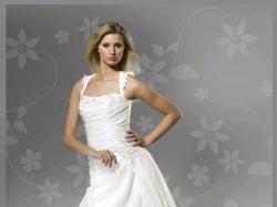 """Sprzedam  suknię ślubną szwedzkiej firmy """"Aspera by Alicja Eklöw"""" w rozmiarze 34"""